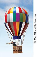 Hot Air Balloon - Businessman in a hot air balloon looking...