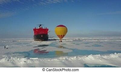 Hot air balloon flying above ice
