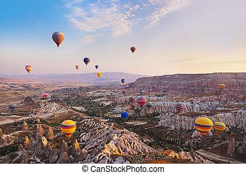Hot air balloon flying over Cappadocia Turkey