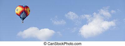 hot air balloon in the cloudy sky