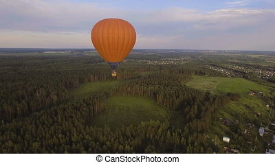 Hot air balloon in the sky over a field.Aerial view - Aerial...