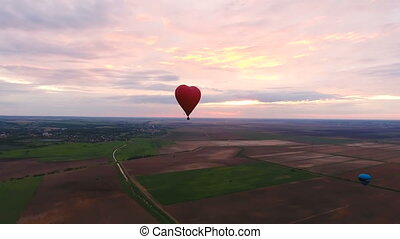 Hot air balloon in the sky over a field.Aerial view