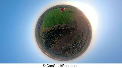 Hot air balloon in the sky over field spherical panorama -...