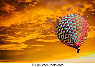 Hot air balloon on sunset.