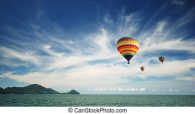Hot air balloon travel over Andaman sea - Beautiful hot air...