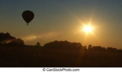 hot air balloon up in sundown