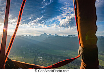 A hot air balloon view from Driggs, Idaho of the Grand Tetons in the Rocky Mountains of Wyoming.