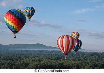 Hot Air Balloons - Colorful hot air balloons floating in the...