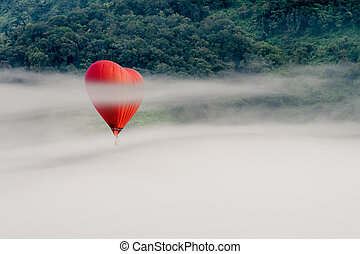 hot air balloons flying over the mountain