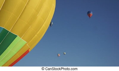 Hot air balloons in clear blue sky