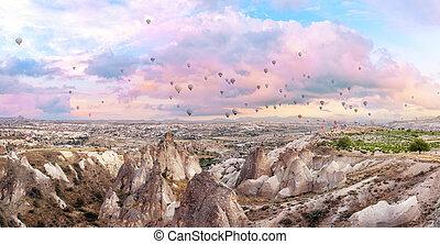 Hot air balloons in pink morning sky over Cappadocia