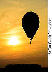 Hot air balloons in the sky flying at sunset