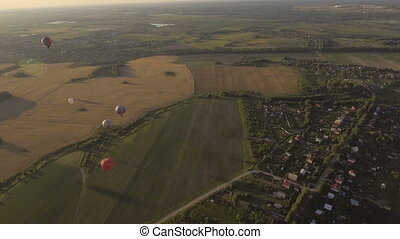 Hot air balloons in the sky over a field.Aerial view -...