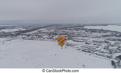 Hot air balloons in the winter.