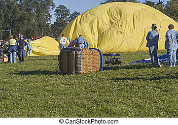 Yellow Hot Air balloon being prepared for lift off
