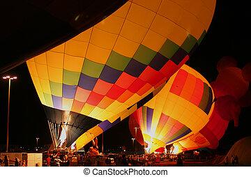 Hot air baloons 5 - A row of hot air baloons aglow
