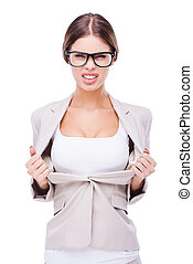 Hot and cheeky businesswomen. Beautiful young businesswoman taking off her jacket and showing her perfect cleavage while standing against white background