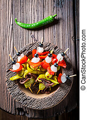 Hot and spicy banderillas with peppers, olives and anchovies