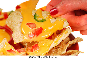 Hot and spicy Nachos - Person holding a tortilla chip with...