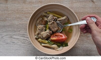 hot and spicy pork bone with mushroom in Thai tom yum soup ...