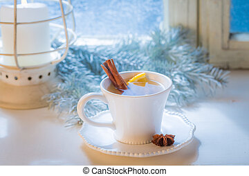 Hot and sweet tea with cinnamon and orange for Christmas