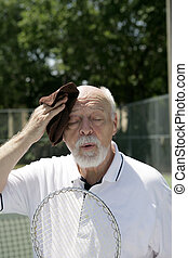 Hot And Tired - A hot and tired senior man wiping his brow ...