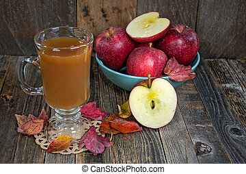 hot apple cider with fall leaves