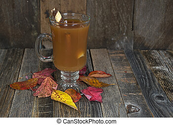 apple cider with striped cinnamon stick