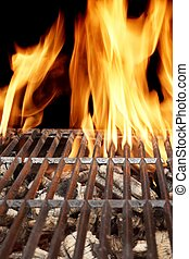 Hot Barbecue Grill With Vibrant Flame On The Black Background