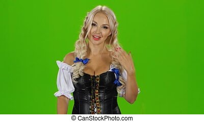 Hot bavarian girl drinking beer. Green screen