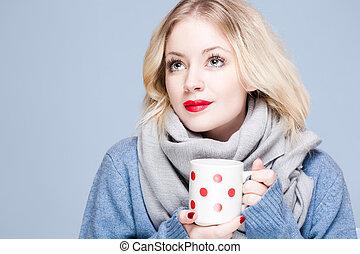 Hot beverage. - Cute fashionable winter blond holding mug of...