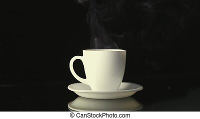 Hot beverage with smoke - Hot beverage on white cup with...