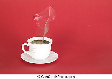 White cup of hot black coffee with smoke, red background