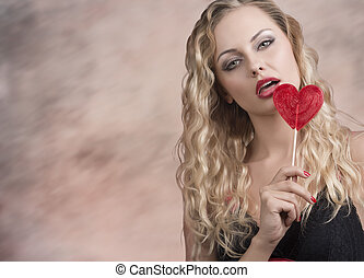 hot blonde girl with red lollipop