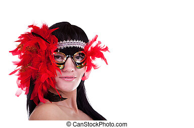 Hot brunette woman with a feathery carnival mask
