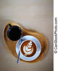 Hot cappuccino in a white cup, placed on a wooden floor.