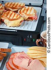 Hot cheese and ham sandwiches, cup of coffee slices - Hot...