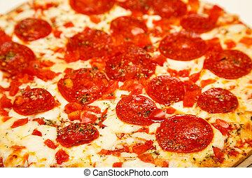 Hot, cheesy, pepperoni pizza ready to eat