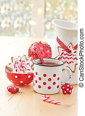 Hot chocolate and colorful decorated christmas cookies