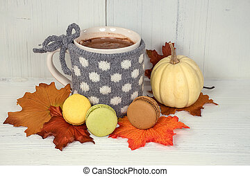 hot chocolate drink with fall leaves