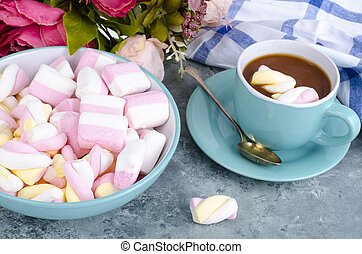 Hot chocolate in blue cup with marshmallows