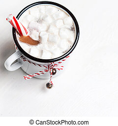Hot chocolate mug with marshmallow with sweet red candy...
