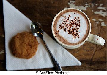 Hot chocolate on wood background
