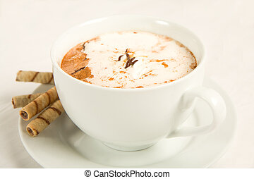 Rich hot chocolate with whipped cream, chocolate, caramel, and cinnamon. Served with cookies.
