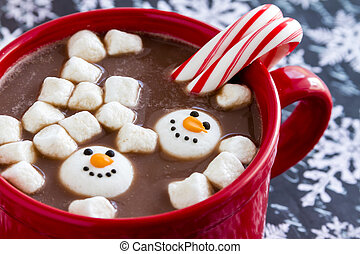 Hot Chocolate with Candy and Cookies - Red mug filled with...