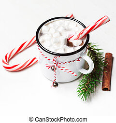 Hot chocolate with marshmallow on white wooden table. Top...