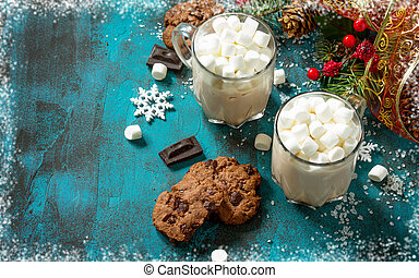 Hot Chocolate with Marshmallows and Homemade Chocolate Chip Cookies on a blue stone or concrete table. Copy space.