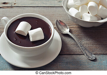 Hot chocolate with marshmallows on wooden background
