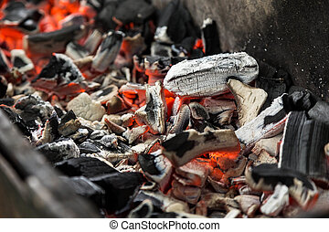 hot close up charcoals in barbecue