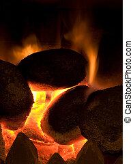Hot coals burning with orange flame